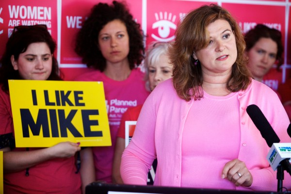 Nicole Clegg, chairwoman of Planned Parenthood Maine's Action Fund PAC, announces the organization's endorsement of Mike Michaud for governor at an event in Portland on Monday.