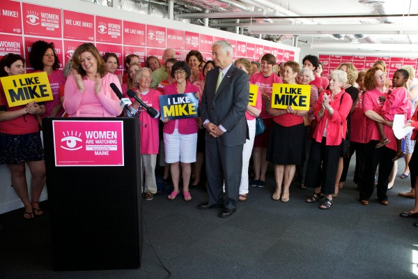 The crowd cheers as Planned Parenthood's Maine Action Fund endorses Mike Michaud for governor on Monday in Portland.