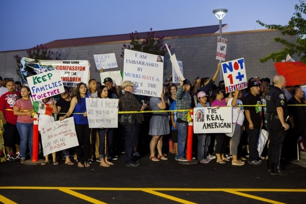 Residents and protestors attend a town hall meeting to discuss the processing of undocumented immigrants in Murrieta, California July 2, 2014.