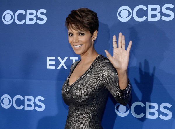 Cast member Halle Berry of the CBS science fiction television series &quotExtant&quot waves at media during the premiere of the series at the Samuel Oschin Space Shuttle Endeavour Display Pavilion in Los Angeles, California, in this June 2014 file photo.