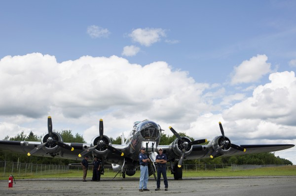 Co-pilots Jim Kimmel (left) and Jim Dennison wait to take a ride in the Sentimental Journey, a fully restored B-17 Flying Fortress, at the Hancock County-Bar Harbor Airport Tuesday in Bar Harbor.