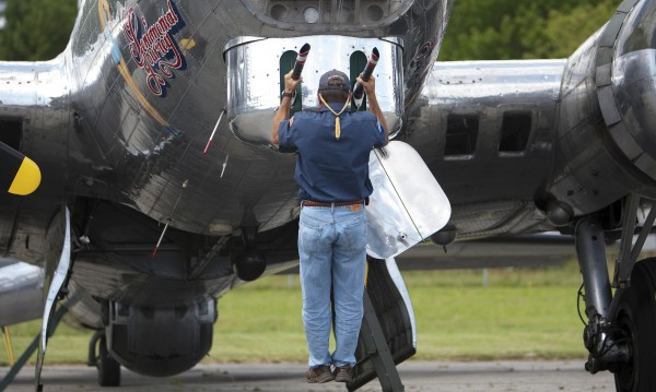 Co-pilot Jim Kimmel does a pull-up on off the front of the Sentimental Journey, a fully restored B-17 Flying Fortress, at the Hancock County-Bar Harbor Airport Tuesday in Bar Harbor.