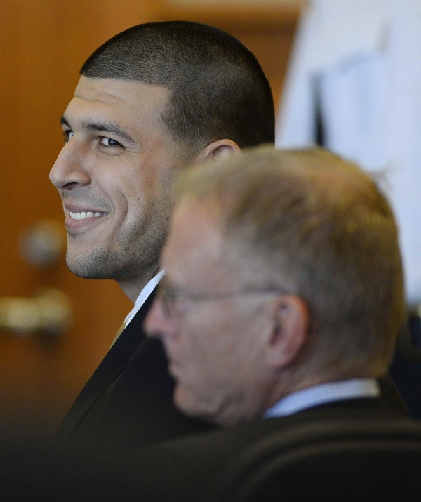 Former NFL player Aaron Hernandez smiles during a hearing on Tuesday in Bristol County Superior Court in Fall River, Massachusetts.