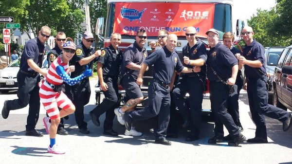 Helene Neville, a nurse from Las Vegas, who is beating cancer,ran from Florida to Maine this month to honor those who have passed and promote a healthy lifestyle. She is greeted by the Portland Fire Department on Sunday.
