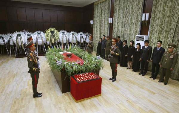 People stand near the bier of former North Korean missile expert Jon Pyong Ho in this undated photo released by North Korea's Korean Central News Agency in Pyongyang on July 10, 2014. Jon, who was placed under sanctions by the United Nations for his role in the country's nuclear and missile weapons programmes has died, state media said on July 9, 2014. Jon, a highly decorated general in the Korean People's Army and senior Worker's Party of Korea figure, died aged 88 of natural causes, state media said.
