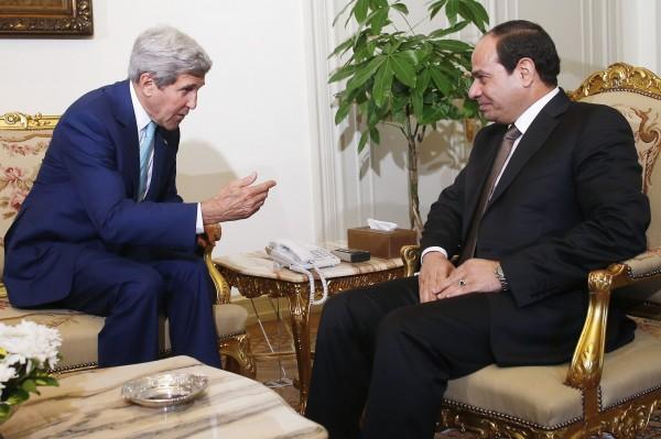 U.S. Secretary of State John Kerry (left) speaks with Egyptian President Abdel Fattah al-Sisi in Cairo on July 22, 2014.