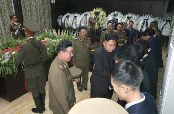North Korean leader Kim Jong Un pays a condolence call at the bier of former North Korean missile expert Jon Pyong Ho in this undated photo released by North Korea's Korean Central News Agency (KCNA) in Pyongyang on July 10, 2014.