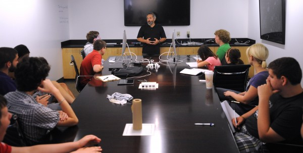 Chuck Carter, President of Eagre Interactive, speaks to participants of the Summer Technology Camp at the University of Maine on Wednesday in Orono.  Carter is video game industry veteran with over three decades of computer graphics experience.