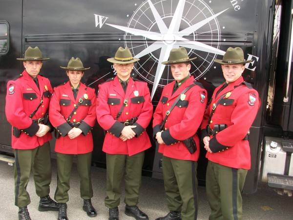 Maine Game Wardens featured in the Animal Planet TV show &quotNorth Woods Law&quot pose for a photo in front of the Maine Warden Service mobile command vehicle on April 5, 2012.