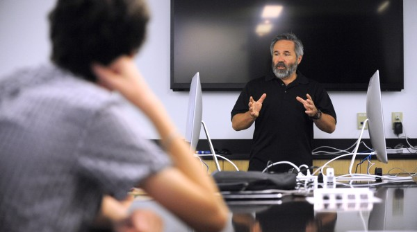 Chuck Carter President of Eagre Interactive speaks participants of the Summer Technology Camp at the University of Maine in Orono Wednesday.  Carter is video game industry veteran with over three decades of computed graphics experience.