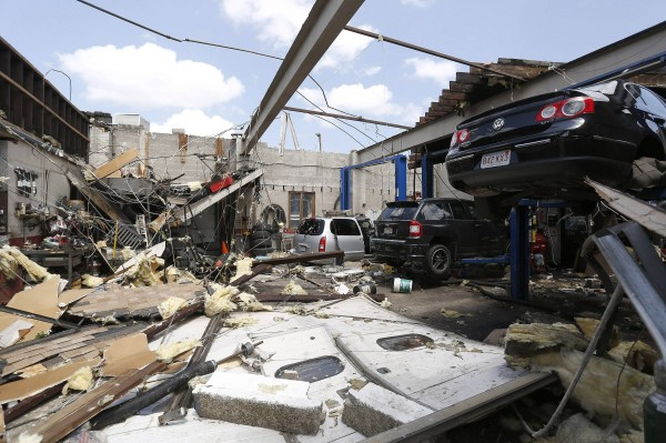 A collapsed roof is seen with damaged automobiles at a car workshop on Herman Street in Revere, Massachusetts, July 28, 2014.