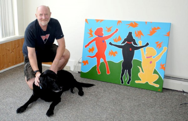 Jim Williams and his Labrador retriever, Pirate, at Mainely Labs in South Portland, with a poster he calls &quotLab Dance.&quot Williams, who previously had a studio in Portland, expects to be open for business at 81 Ocean St. in Knightville later this month.