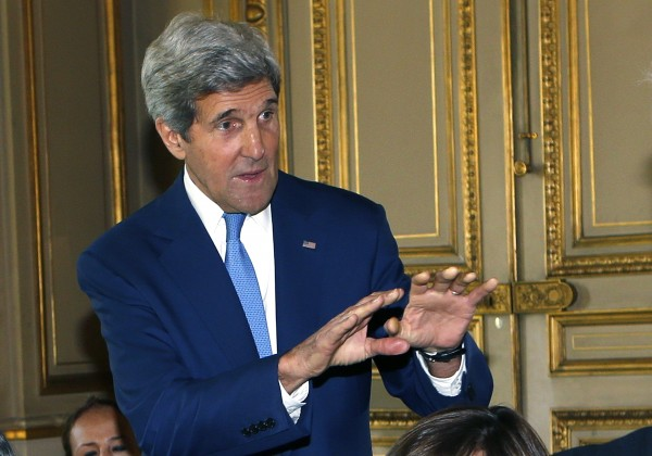 U.S. Secretary of State John Kerry gestures at the start of a Middle East crisis meeting at the Quai d'Orsay in Paris, July 26, 2014.