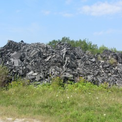 Pictured is one of the piles of fiber material stored on 70 acres in Warren at a former rifle range.
