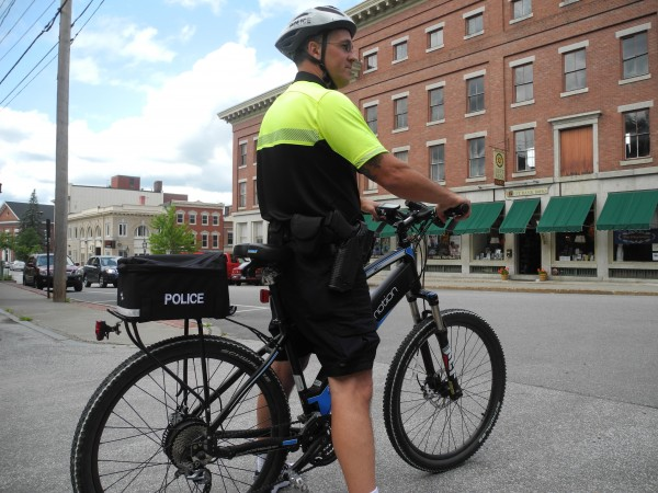 Officer Jim Bergdoll patrols the city while riding a new electric bicycle, which officials say expands the efficiency and range of bike officers.