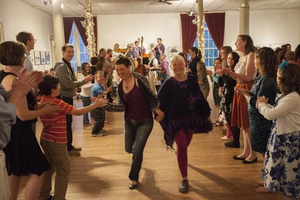 Maria McMorrow  of Machias and Sally Erickson of Eastport dance down the line at the Eastport Strings contra dance at the Easport Arts Center in May.