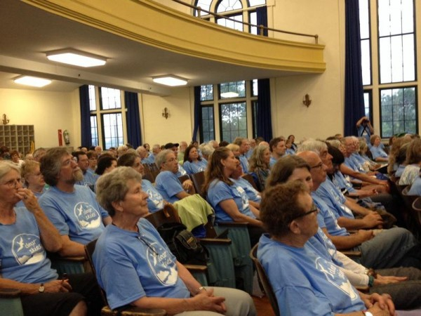 Dressed in blue T-shirts, more than 200 supporters of banning tar sands from South Portland applauded the work of the special draft ordinance committee at Mahoney Middle School on June 26 during a South Portland City Council workshop.