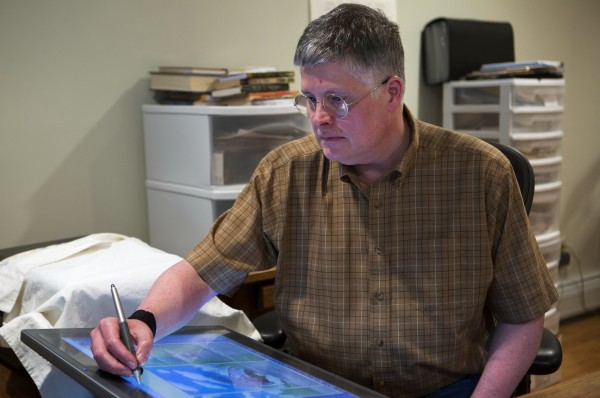Maine-based author/illustrator Mark Scott Ricketts shows how he illustrates his books using a Cintiq tablet Thursday at his home in Bangor. Ricketts recently published his first children's book &quotAdventures in Vacationland.&quot