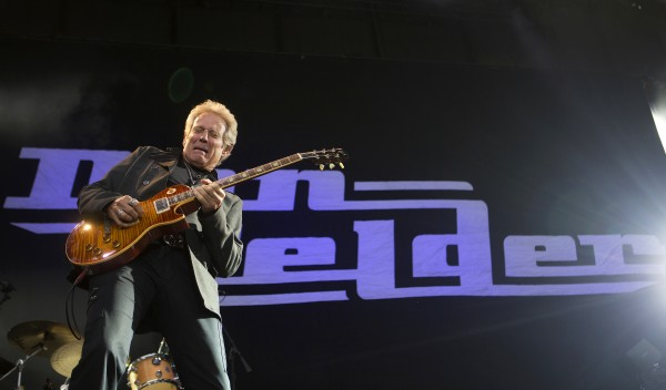 Don Felder plays guitar during the Styx, Foreigner and Don Felder show Saturday at the Darling's Waterfront Pavilion in Bangor.