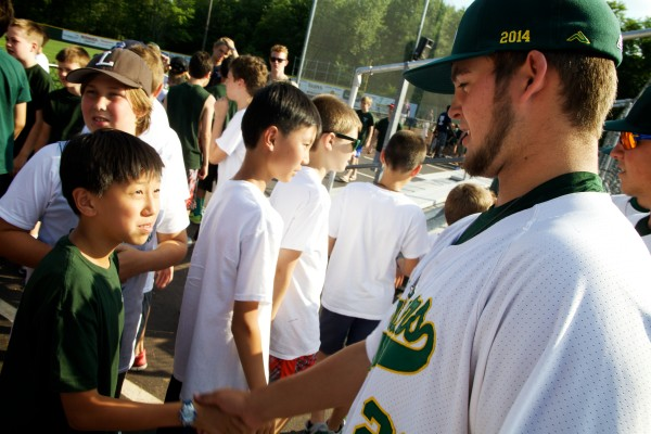 Sanford Mainer Anthony Ciavarella shakes hands with kids from a nearby summer camp at a meet-and-greet before the game Monday night at Goodall Park.