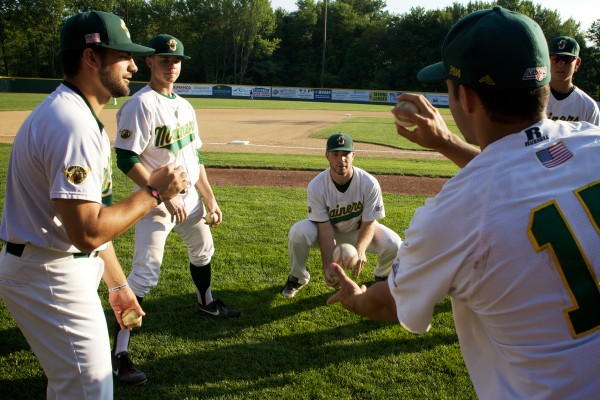 Sanford Mainers play &quotaround the horn&quot before their game monday night at Goodall Park. The Mainers are currently in second place in the northern division of the New England Collegiate Baseball League.