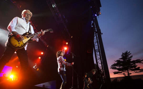Foreigner's Mick Jones (left), Kelly Hansen (center), and Jeff Pilson rock out during the Styx, Foreigner and Don Felder show Saturday at the Darling's Waterfront Pavilion in Bangor.