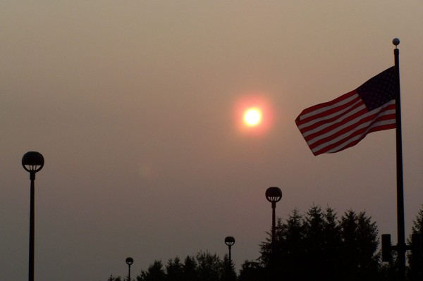 Smoke traveling thousands of miles to Maine from the western United States is creating hazy conditions over the state this weekend, partially obscuring the sun in Caribou Saturday morning and prompting air quality warnings.