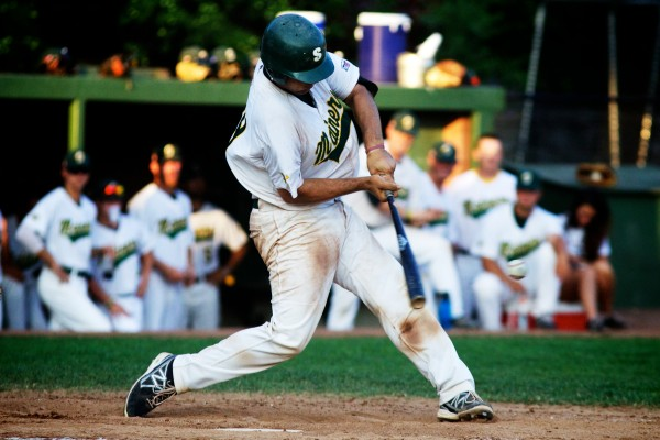 Catcher Steven Berman of the Sanford Mainers takes a rip at the plate Monday night.