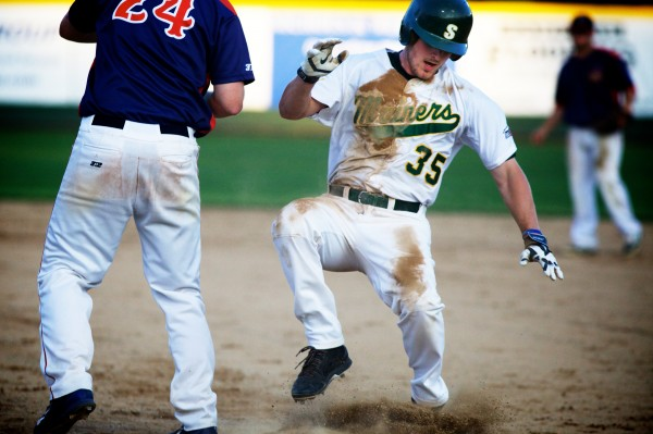 Texan Walker Pennington stumbles as he scrambles back to first base Monday night as the Sanford Mainers took on the Valley Blue Sox in the New England Collegiate Baseball League.