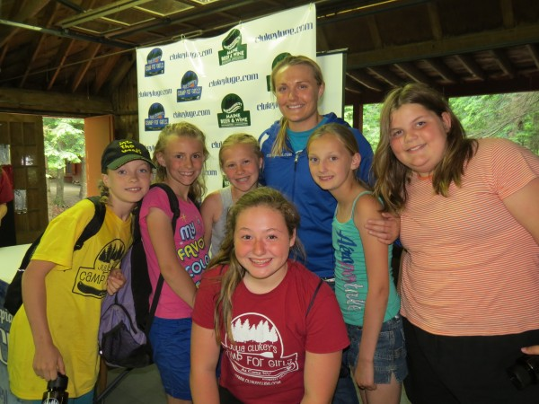 Julia Clukey (center) poses for a photo with some of the participants during her week-long Camp For Girls in June at Maranacook Lake in Readfield.
