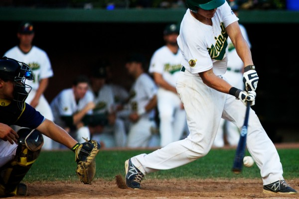 University of Southern Maine junior Sam Dexter makes contact in a Sanford Mainers game on Monday night. The Mainers play in the New England Collegiate Baseball League.