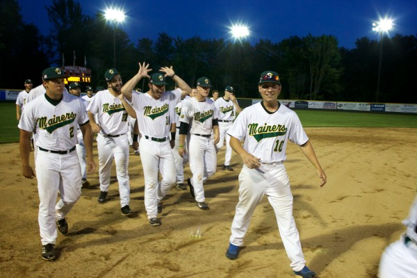 Right-handed pitcher John Nicklas makes the sign of the moose -- the team mascot -- as the Sanford Mainers celebrate a walk-off victory Monday night.