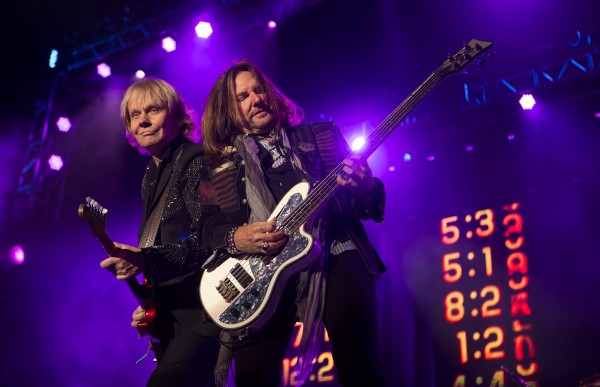 Styx's James Young (left) and Ricky Phillips rock out during the Styx, Foreigner and Don Felder show Saturday at the Darling's Waterfront Pavilion in Bangor.