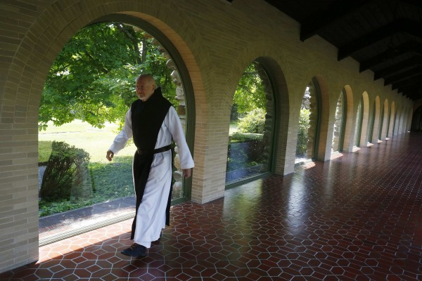 A Trappist Monk walks to midday prayers at Saint Joseph's Abbey in Spencer, Massachusetts on July 22, 2014.