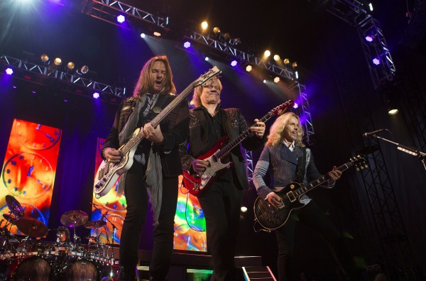 Styx's Ricky Phillips (left), James Young (center), and Tommy Shaw perform during the Styx, Foreigner and Don Felder show Saturday at the Darling's Waterfront Pavilion in Bangor.