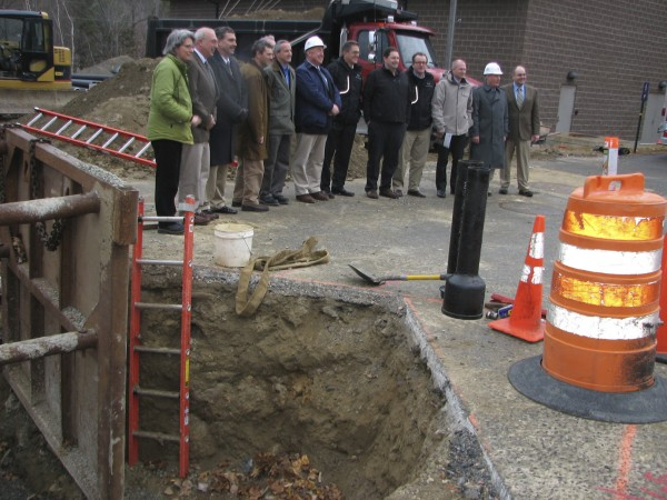 Project officials gather in November 2010 at The Jackson Laboratory in Bar Harbor at the site of a future wood pellet boiler building.