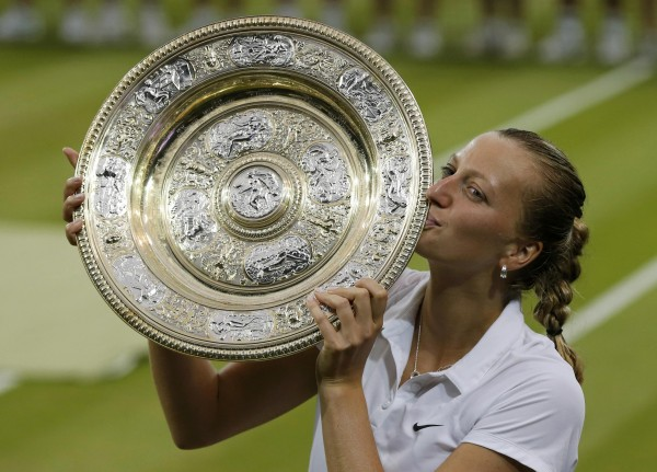 Petra Kvitova of the Czech Republic kisses the winner's trophy, the Venus Rosewater Dish, after defeating Eugenie Bouchard of Canada in their women's singles final tennis match at the Wimbledon Tennis Championships in London July 5, 2014.