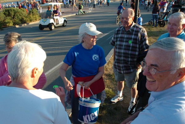 Volunteer Maria Hantala of Levant (center) collects donations from festival goers at the opening night of the American Folk Festival on the Bangor Waterfront on Friday, Aug. 27, 2010.
