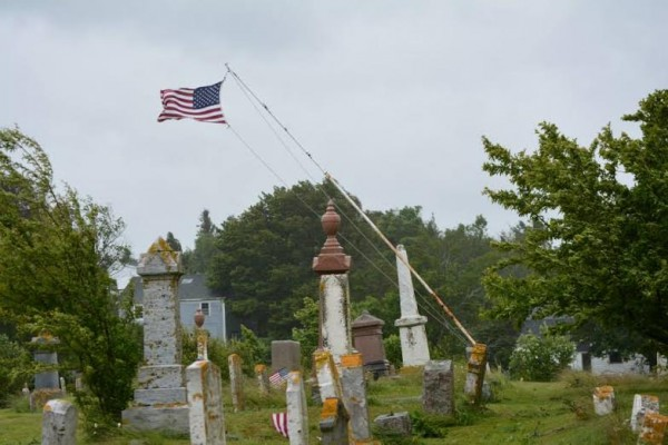 High winds from the weekend storm bent this flag pole in a cemetery in Lubec.