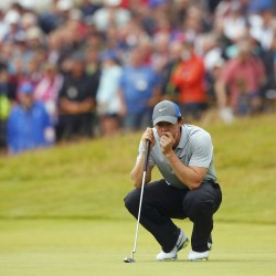 McIlroy in control at British Open; Tiger barely survives to make cut
