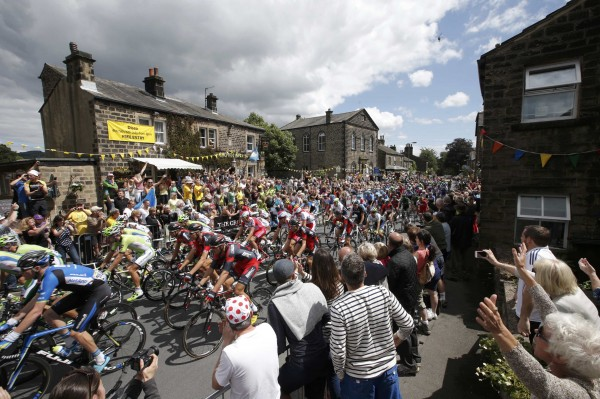 The pack of riders cycles on its way during the first 190.5-km stage of  the Tour de France cycling race from Leeds to Harrogate, July 5, 2014.