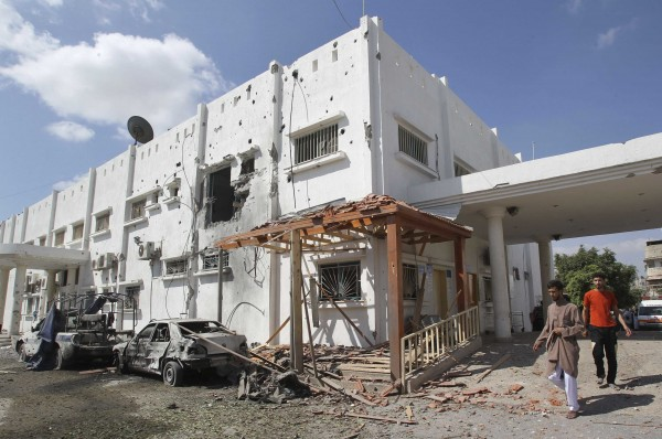 Palestinians look at the damaged hospital on Saturday in Beit Hanoun town, which witnesses said was heavily hit by Israeli shelling and air strikes during Israeli offensive, in the northern Gaza Strip.
