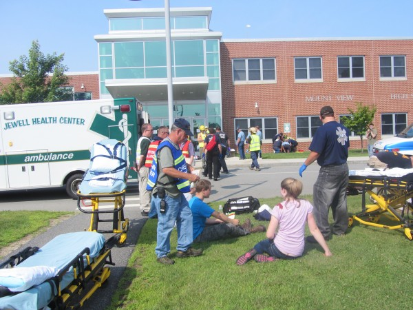 Emergency medical staff and people portraying victims of a school shooting during an emergency drill at Mount View High School in Thorndike.