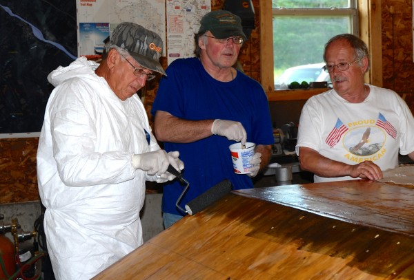 Boat builders Patrick Ayotte Jr. (left), Dave Wylie (center) and Gerald Soucy discuss the final plans for the Acadian Queen, a historical replica of a St. John River ferry boat.