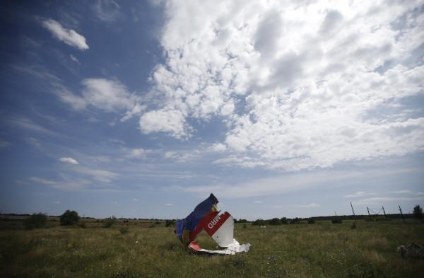 A part of the wreckage of Malaysia Airlines Flight MH17 is pictured at its crash site, near the village of Hrabove, Donetsk region. Secretary of State John Kerry on Sunday laid out what he said was overwhelming evidence of Russian complicity in the downing of the Malaysian airliner in eastern Ukraine.