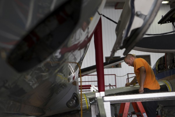 C&L Aerospace employee Brian Hart works to install a leading edge of a plane Thursday. The company is expanding and plans to add 50 or more jobs this year.