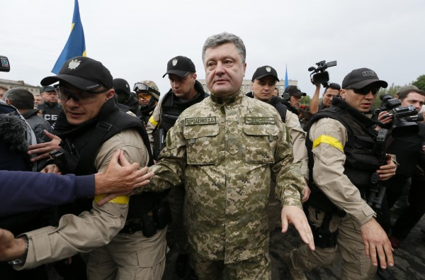 Ukrainian President Petro Poroshenko makes his way during a meeting with local residents in the eastern Ukrainian town of Slaviansk, July 8, 2014.