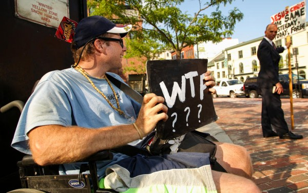 Cory Tracy, left, trades glances with Brother Terry from the Deliverance Center during their daily protests in Portland's Congress Square Park. Tracy, an atheist, has been protesting against proselytizers from the church since May. Brother Terry declined to provide his last name.