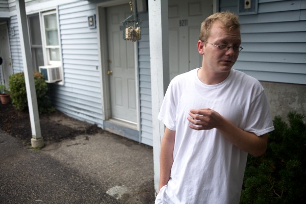 Aaron Petrin speaks outside his apartment in Saco on Monday. He said he heard something that sounded like fireworks inside his neighbor's apartment on Saturday.