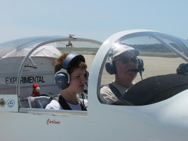 A pilot (right) and student Jack Lord discuss the flight they're about to take in a hand-built Van's RV-9A at Brunswick Executive Airport during Maine ACE Camp on Monday.